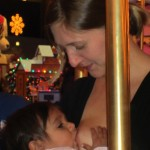 Breastfeeding Veda (one year) on a Carousel at Winter Wonderland in Chicago