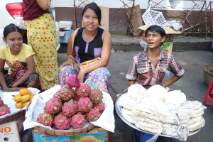 Women in downtown Yangon selling dragonfruit